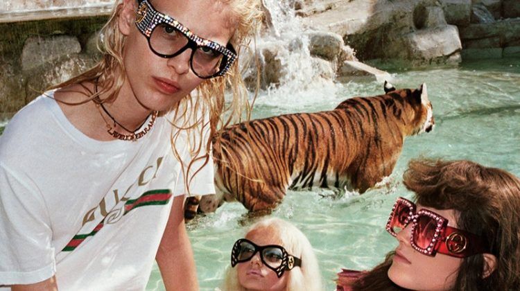 Models pose at the Trevi Fountain in Rome for Gucci's spring 2017 campaign
