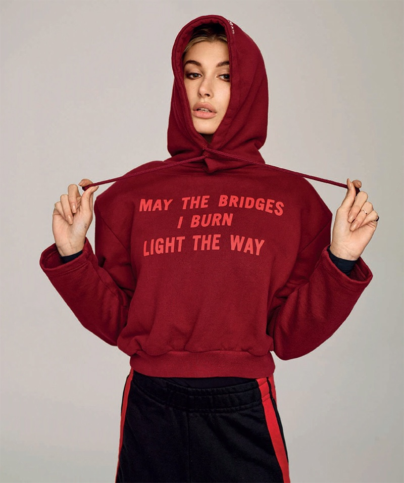 Hailey Baldwin covers up in Vetements hooded sweatshirt and track pants