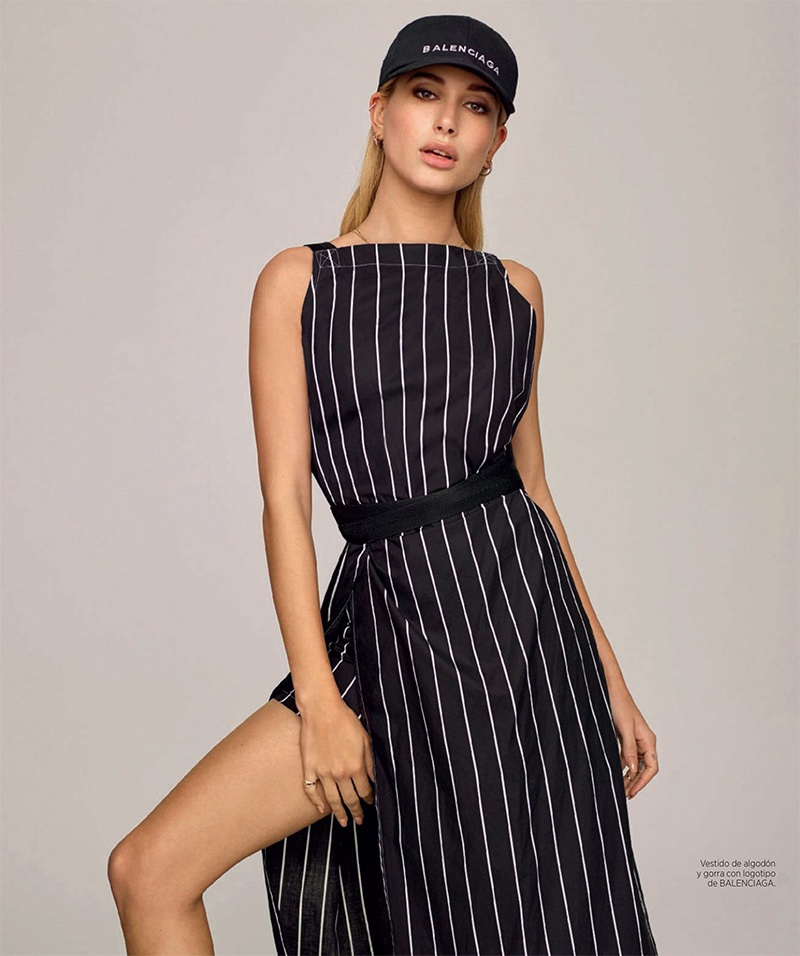 Getting sporty, Hailey Baldwin wears Balenciaga baseball cap and striped dress