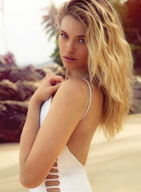 Photographed at the beach, Hailey Clauson models white one-piece swimsuit