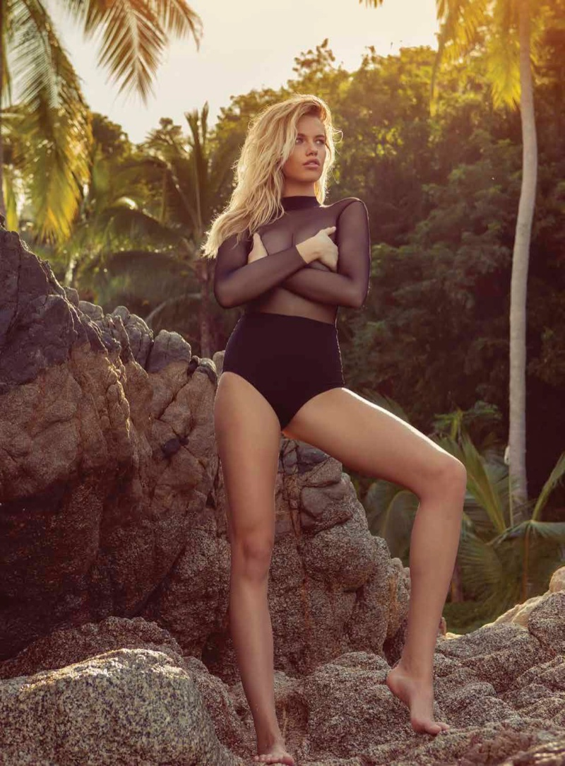 Showing off her legs, Hailey Clauson poses in mesh top and high-waist bikini bottoms