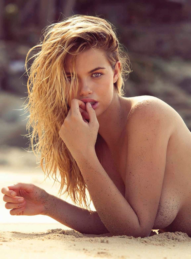 Posing on the sand, Hailey Clauson strips down for this sexy shot