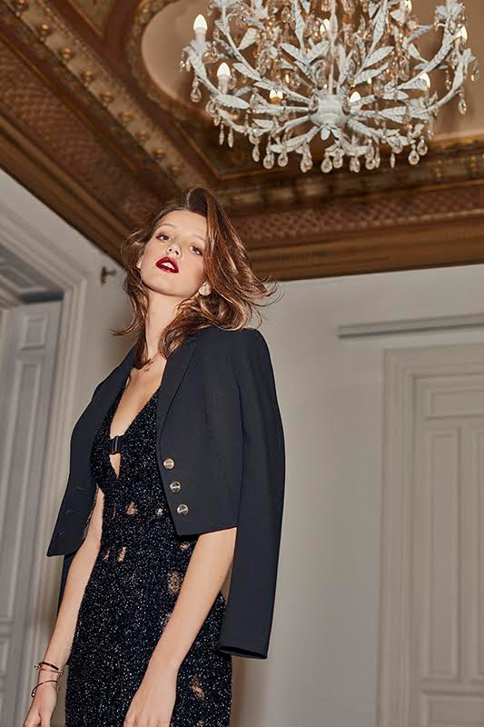 Heloise Giraud models a cropped jacket with black dress