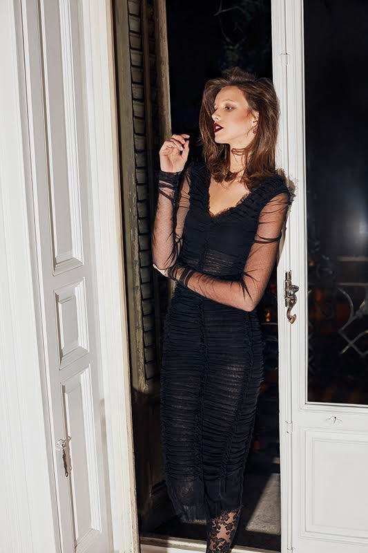 Model Heloise Giraud wears black sheath dress from Dolce & Gabbana