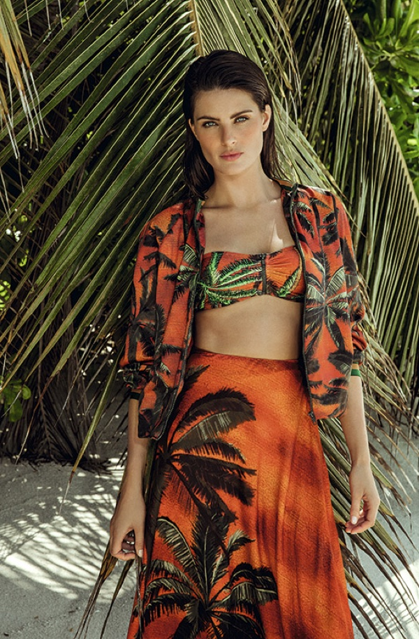 Isabeli Fontana covers up in printed bomber jacket, bandeau top and skirt from Agua de Coco