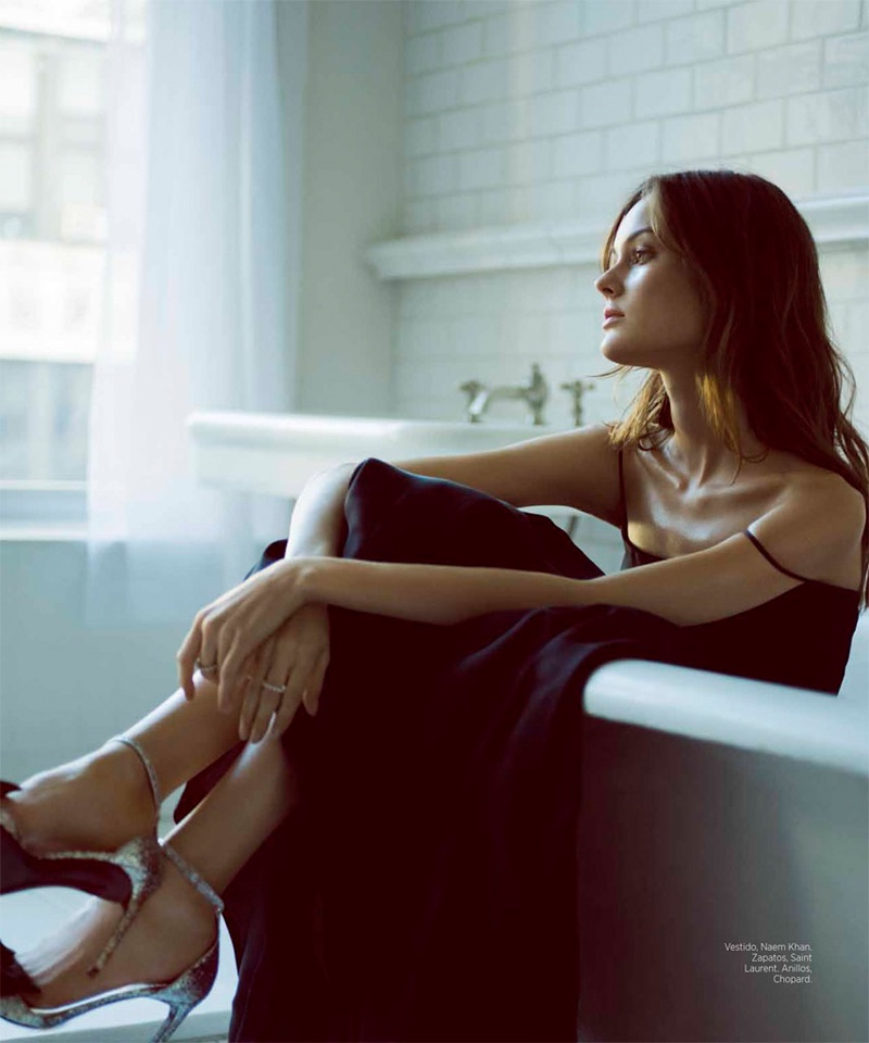 Sitting in a tub, Jac Jagaciak wears Naem Khan dress and Saint Laurent heels