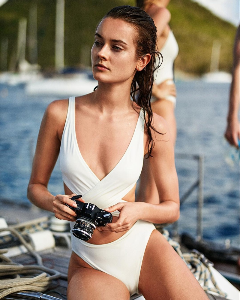 Jac Jagaciak soaks up the sun in The Poppy wrap one-piece swimsuit