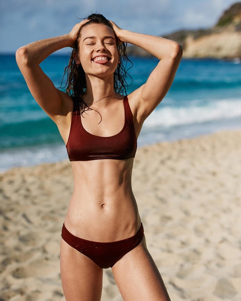 All smiles, Jac Jagaciak poses in The Elle bikini from Solid & Striped