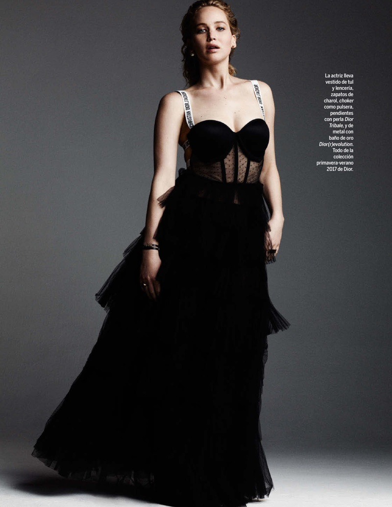 Posing in a studio, Jennifer Lawrence wears a tulle dress and lingerie from Dior