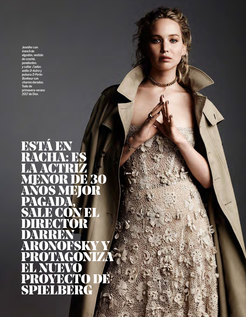 Jennifer Lawrence poses in a trench coat and crochet dress from Dior