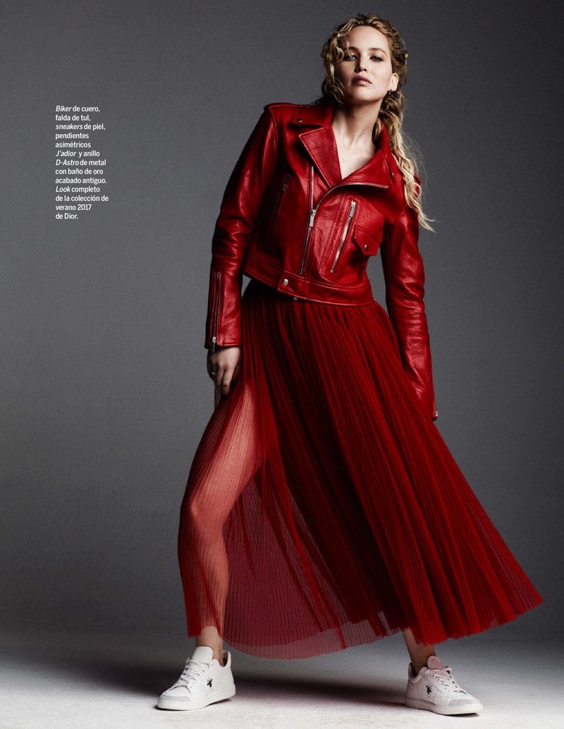 Wearing all red, Jennifer Lawrence poses in Dior biker jacket, tulle skirt and leather sneakers