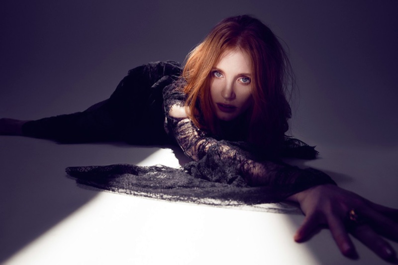 Going into the light, Jessica Chastain wears black lace dress