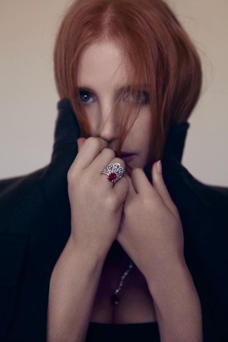Actress Jessica Chastain covers up in Prada coat with Piaget jewelry