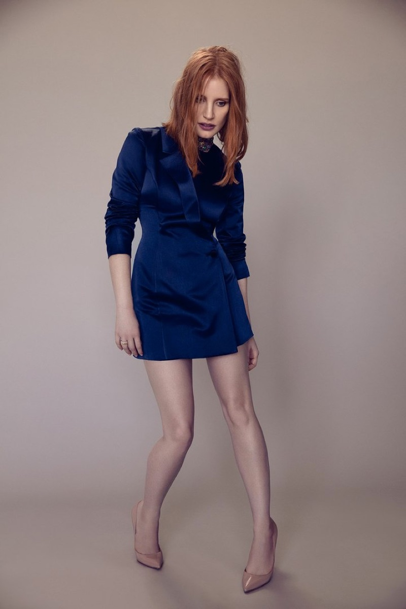 Actress Jessica Chastain poses in blue suit jacket with nude pumps
