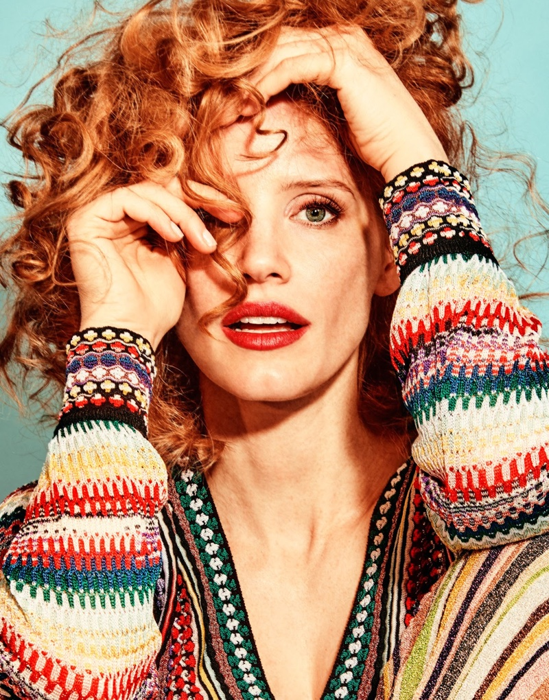 Wearing red lipstick, Jessica Chastain poses in Missoni knit top