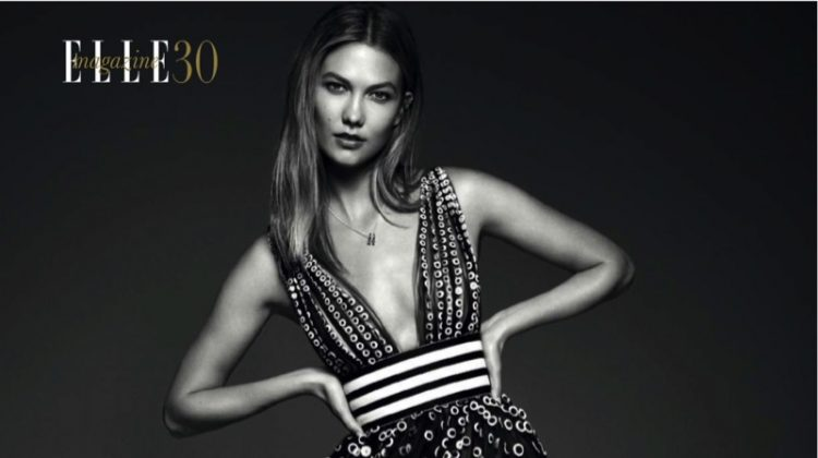 Model Karlie Kloss wears semi-transparent Carolina de Herrera dress and CH Carolina Herrera jewelry