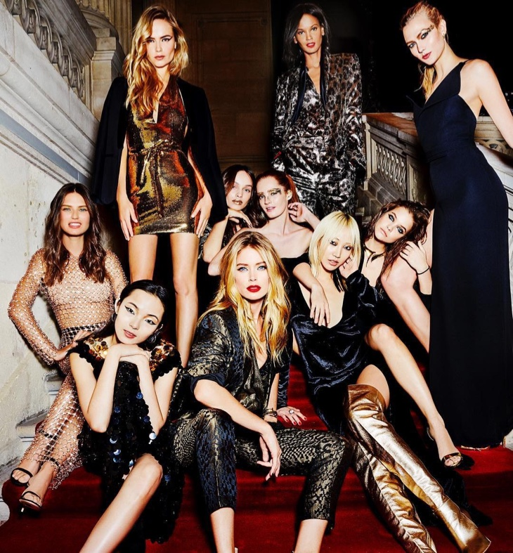 Sitting on stairs, L'Oreal Paris models take a glamorous group shot