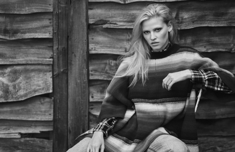 Lara Stone covers up in Chloe sweater, Saint Laurent shirt and Tibi jeans