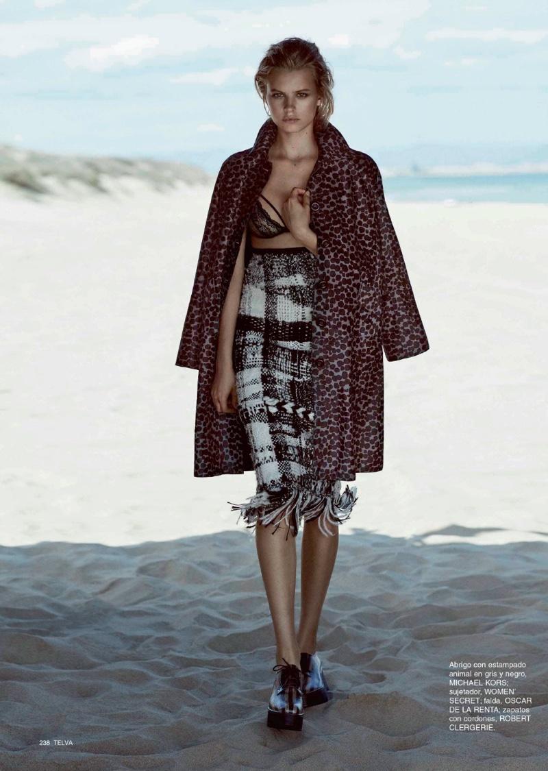 Model Linda Slava poses in Michael Kors jacket with Women Secret bra and Oscar de la Renta skirt