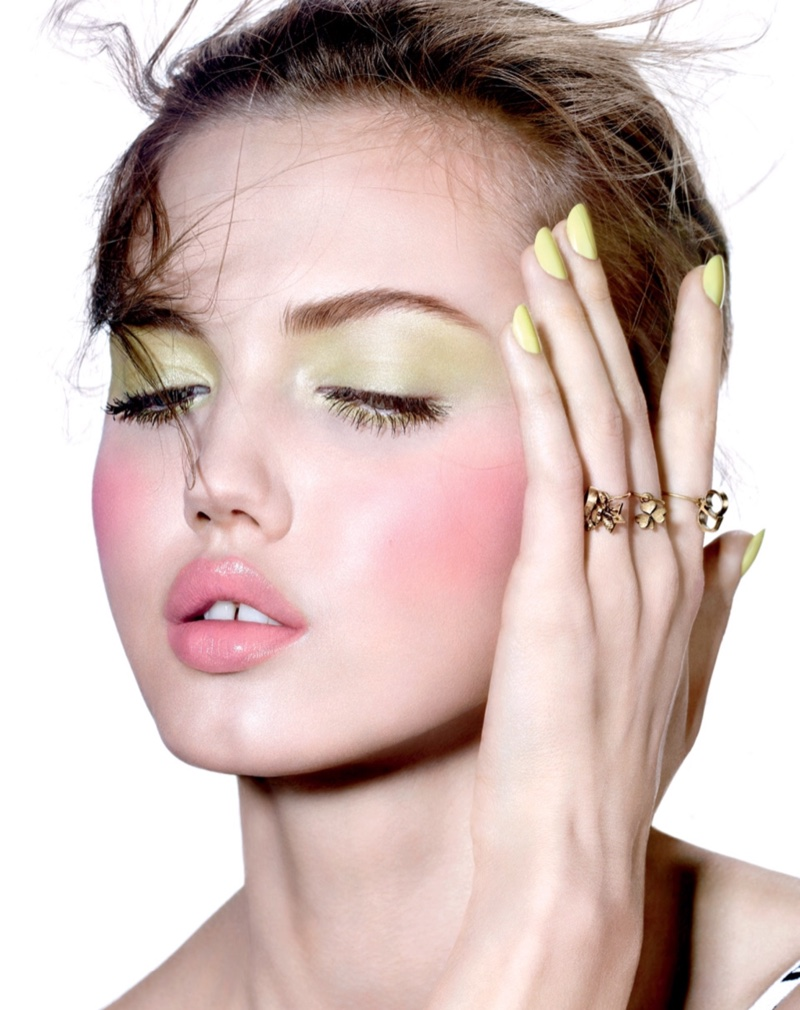 Embracing pastels, Lindsey Wixson wears green eyeshadow and pink blush