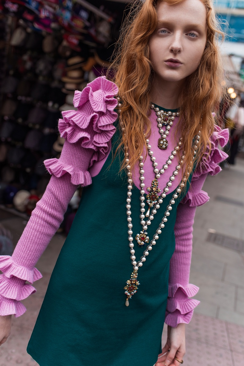 Model Madison Stubbington poses in Gucci dress with ruffles and faux pearls, beads and crystals