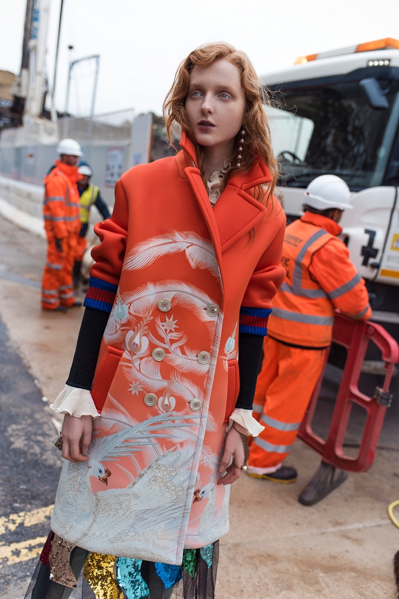 Covering up, the model poses in a look from Gucci's fall-winter 2016 collection