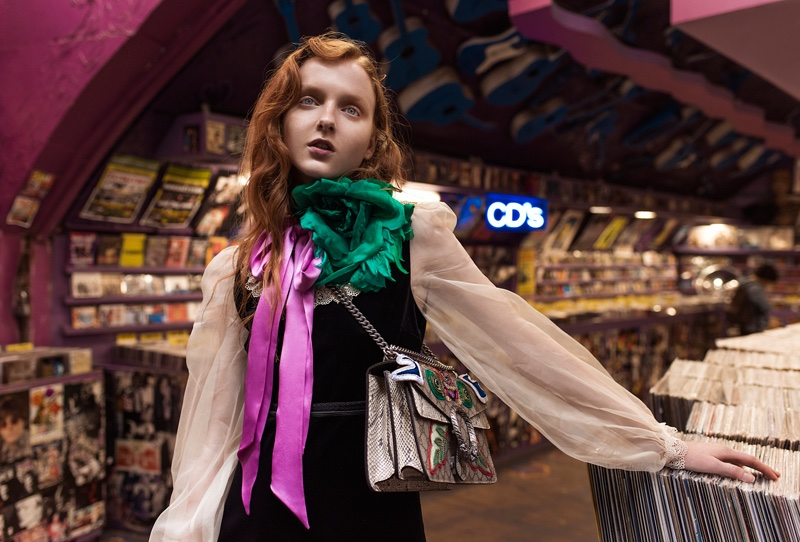 Madison Stubbington poses in a London marketplace wearing Gucci blouse, dress and bag