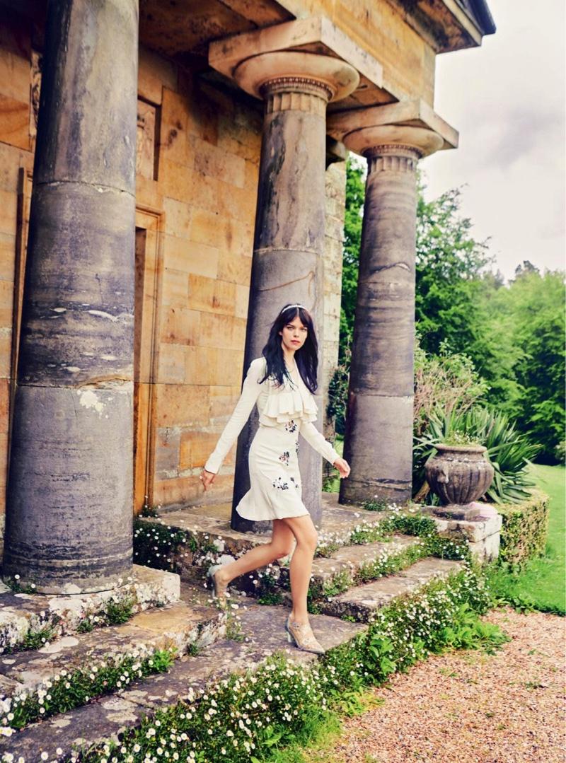 Model Meghan Collison wears Dior crepe and silk dress with Simone Rocha heels