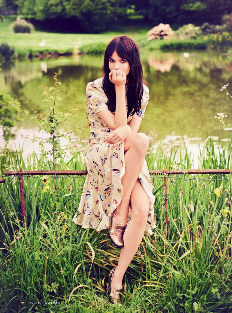 Posing in the grass, Meghan Collison models Hilfiger Collection dress and heels