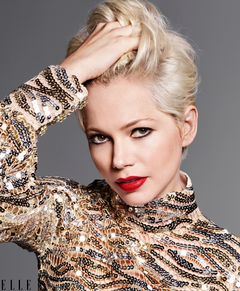 Wearing red lipstick, Michelle Williams poses in sequined Marc Jacobs dress