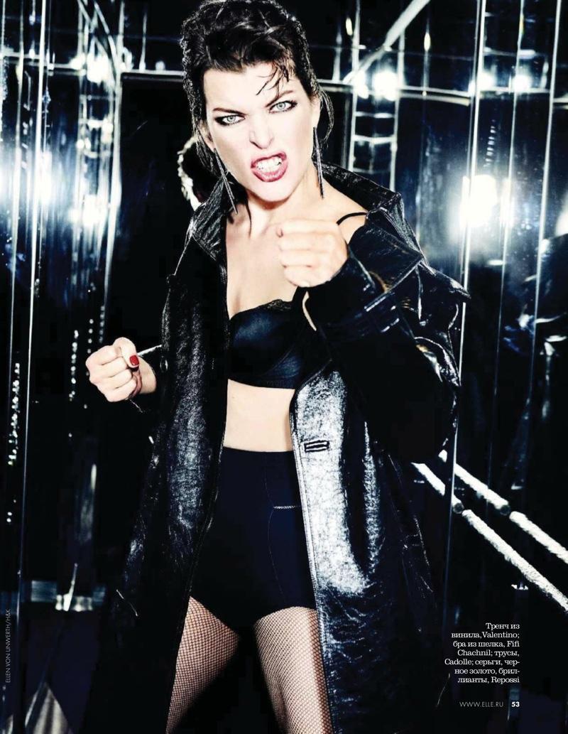 Serving punk attitude, Milla Jovovich wears Valentino coat with Repossi earrings