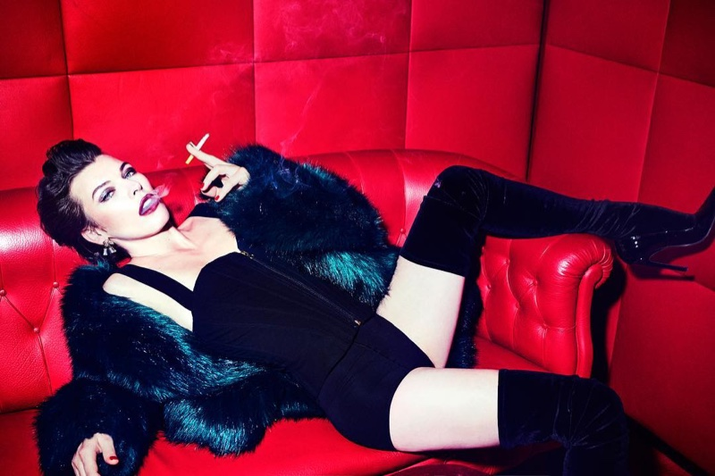 Milla Jovovich wears Dries Van Noten fur jacket with Cadolle lingerie and Balenciaga pumps