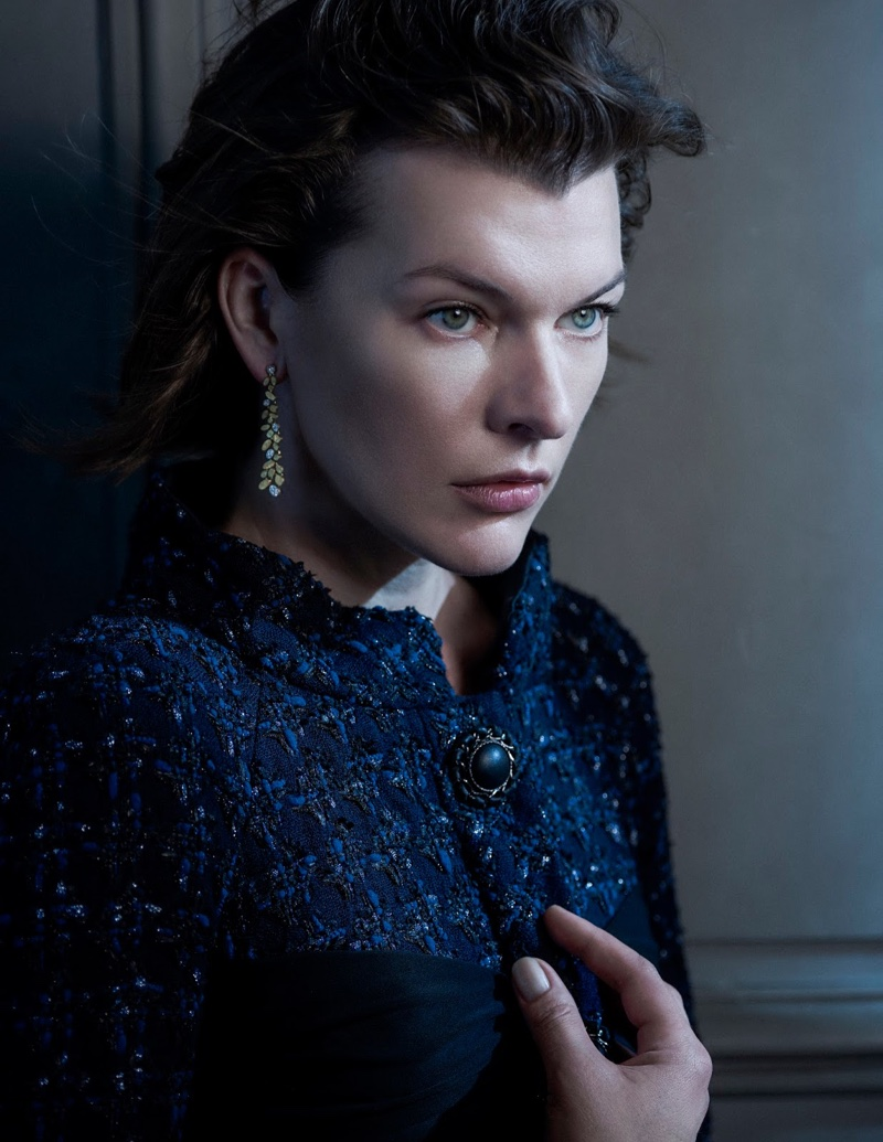 Milla Jovovich wears sparkling tweed jacket with drop earrings