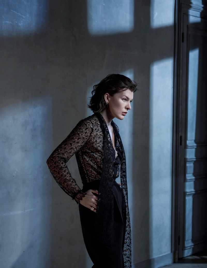 Milla Jovovich poses in lace top and trousers