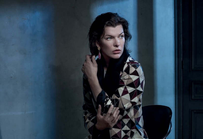 ctress Milla Jovovich wears geometric print jacket with statement earrings