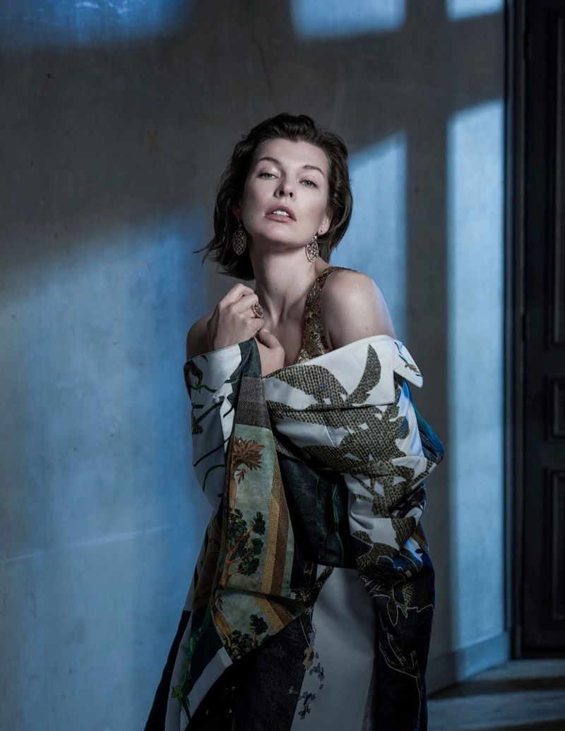 Actress Milla Jovovich gets wrapped up in embroidered coat