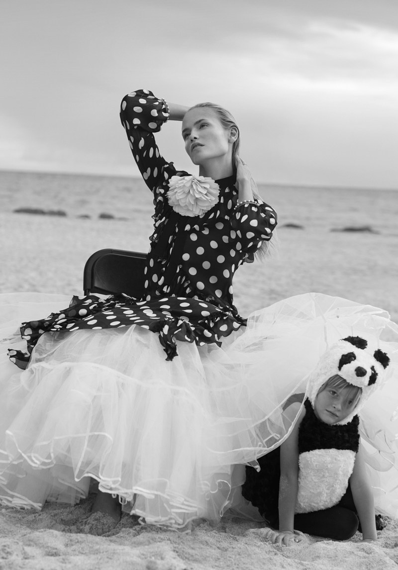 Model Natasha Poly wears Gucci silk and charmeuse dress with polka dot print and tulle skirt