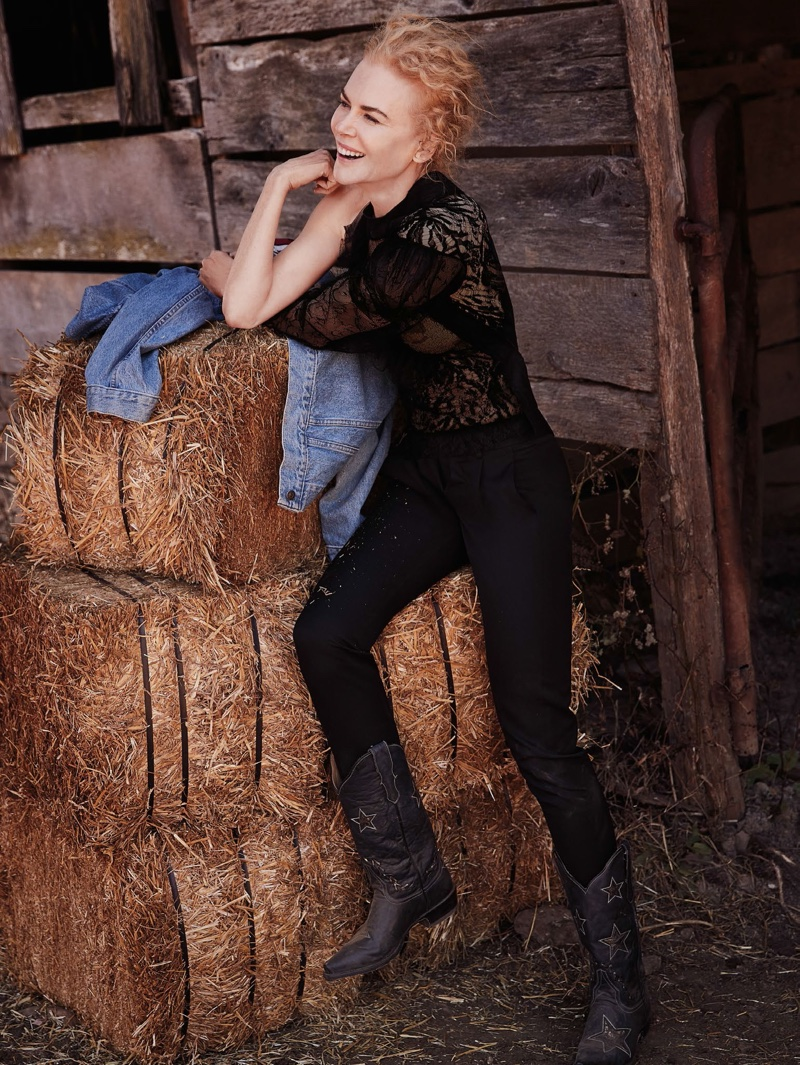 Flashing a smile, Nicole Kidman wears Saint Laurent top and pants with Stetson boots