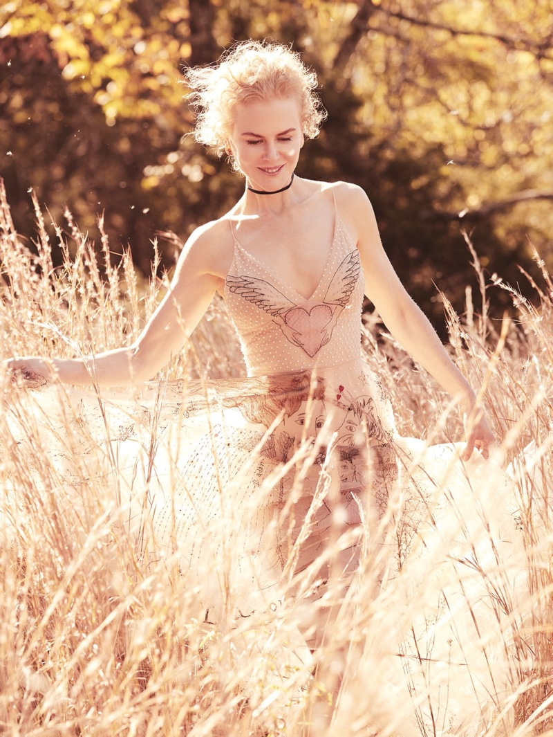 Posing outdoors, Nicole Kidman wears Dior dress