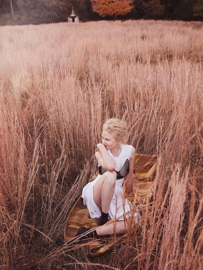 Lounging on a blanket, Nicole Kidman poses in Celine dress and Falke socks