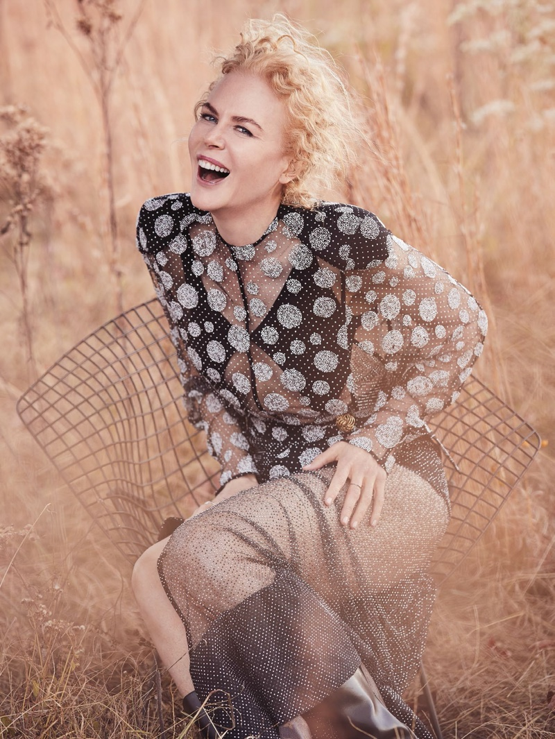 Nicole Kidman poses in Louis Vuitton dress, bodysuit and boots