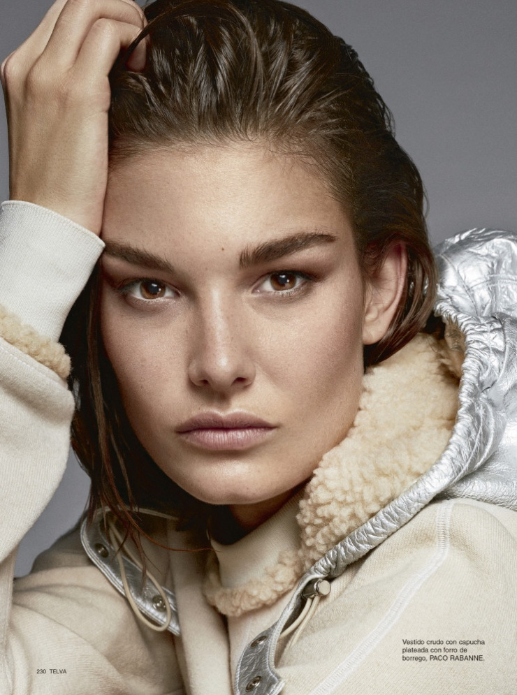 Getting her closeup, Ophelie Guillermand wears hooded Paco Rabanne dress
