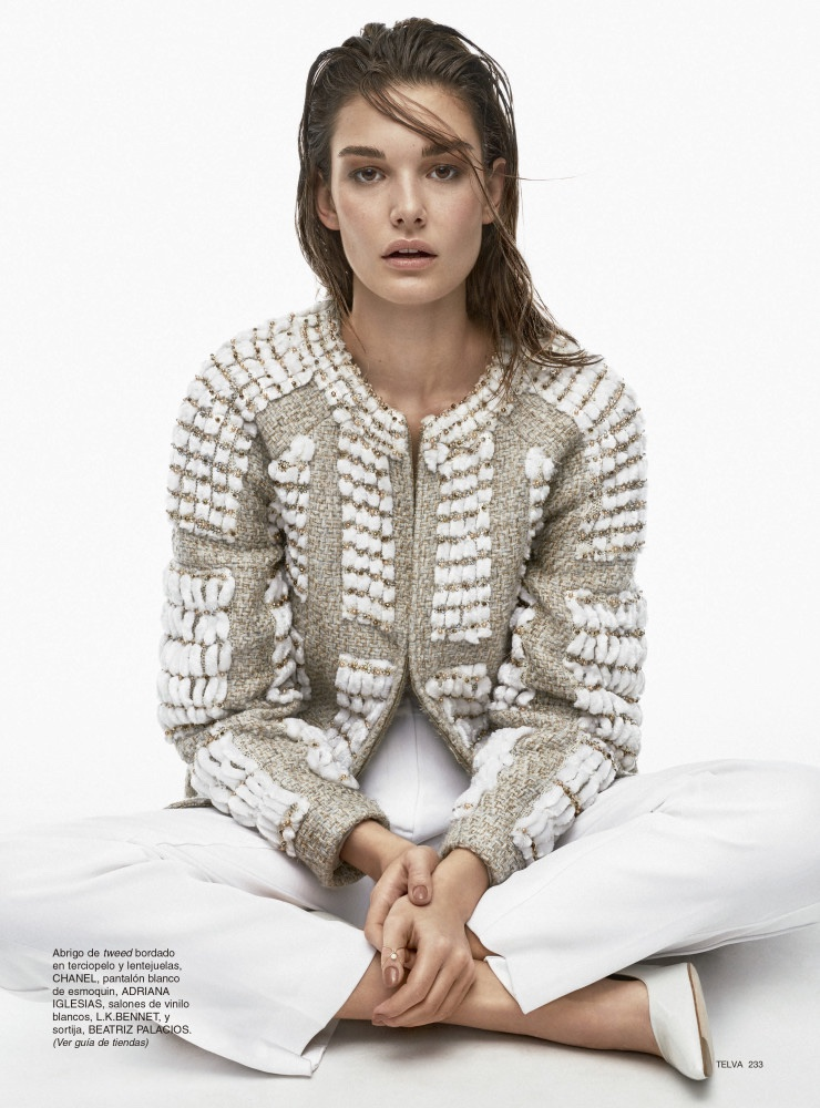 Taking a seat, Ophelie Guillermand wears Chanel tweed jacket with Adriana Iglesias pants and L.K. Bennet heels