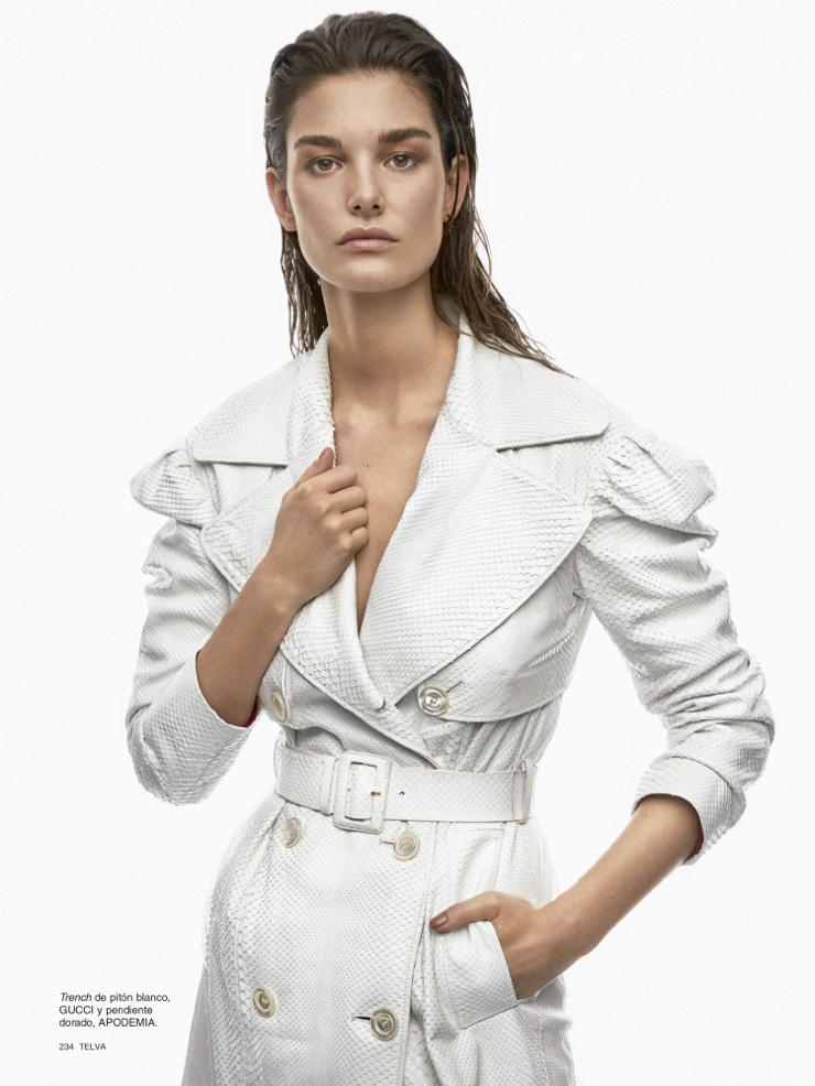 Ophelie Guillermand covers up in white Gucci python trench coat