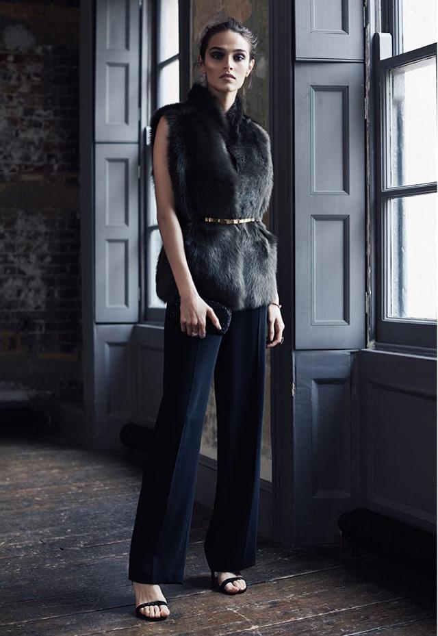 REISS Tessa Reversible Olive Shearling Vest, Natalie Lace-Top Jumpsuit, Jasper Slim Metal-Detail Belt, Malva Crystal Embellished Heels and Ancona Fully-Embellished Clutch Bag