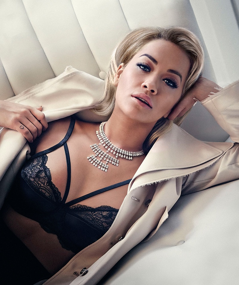 Singer Rita Ora lounges in Loewe coat, Tezenis bra, Dior skirt and Messika jewelry