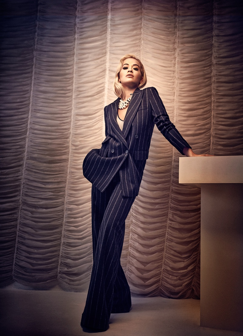 Suiting up, Rita Ora wears Max Mara pinstriped suit and Chanel necklace
