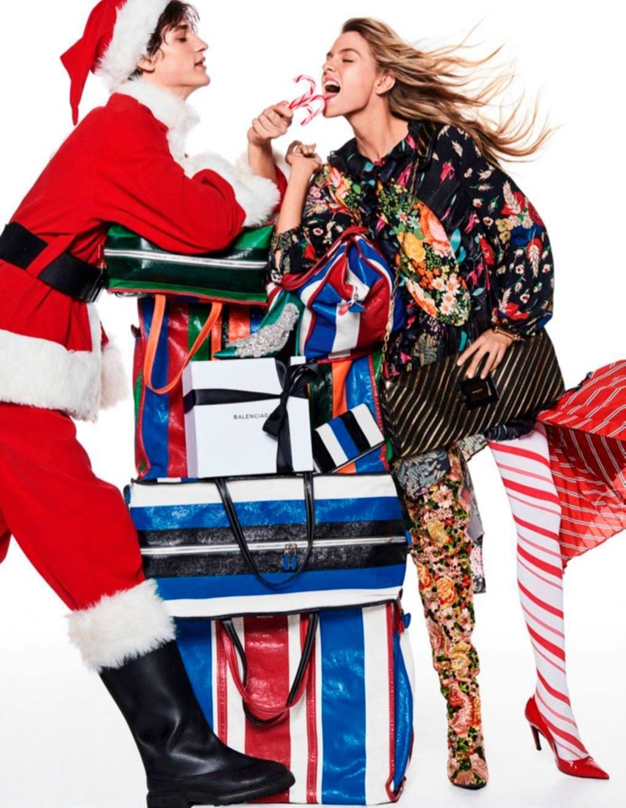 Eating a candy cane, Stella Maxwell wears a Balenciaga dress