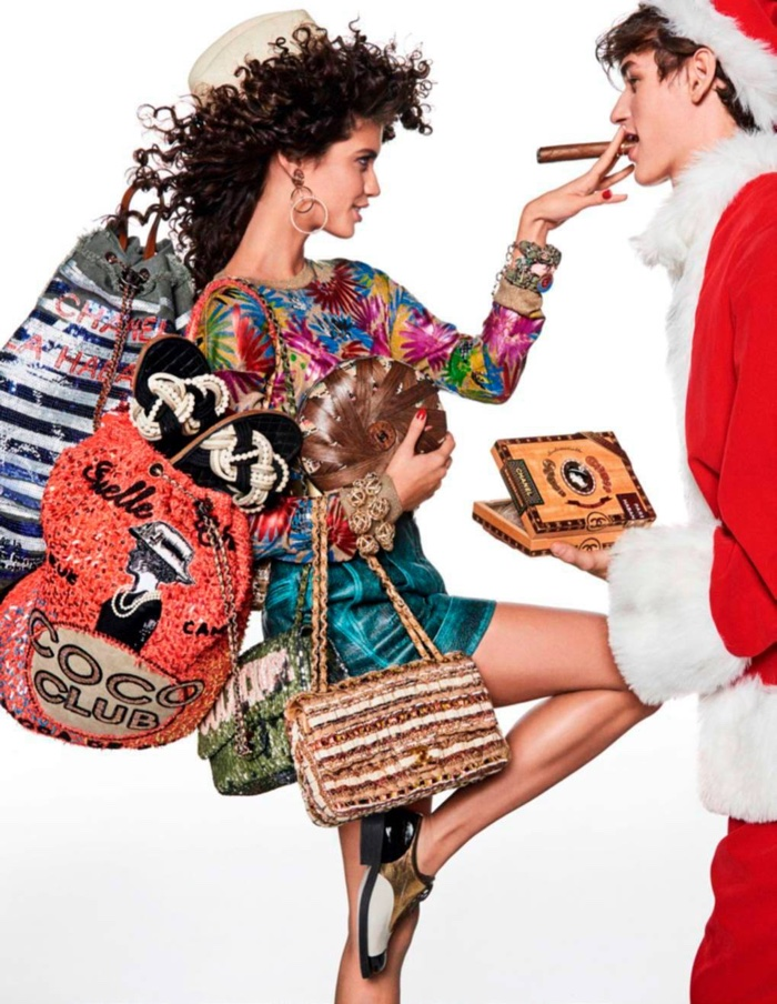 Posing with Santa, Sara Sampaio wears Chanel look and bags