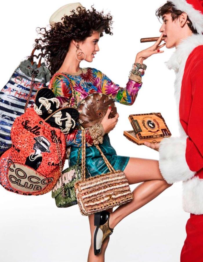 Posing with Santa, Sara Sampaio wears Chanel look and bags